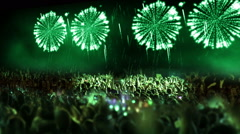 Crowd of people and fireworks explosions (pan camera green) Stock Footage
