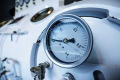 Close up of barometer in natural gas production industry Stock Photos