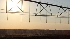 Center pivot irrigation at sunset Stock Footage