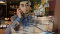 Young man businessman talking on the phone with a good mood Stock Footage