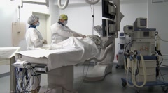 Two surgeons carried out heart surgery. Stock Footage