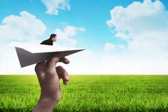 Business man ready to launch with the paper plane - stock photo
