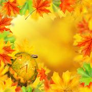 Stock Photo of halloween pumpkin in frame of autumn leaves