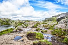 Hiking trail and alpine landscape of the Preikestolen - stock photo