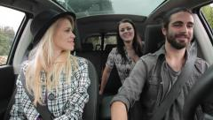 Cool couple picking up a friend with car Stock Footage