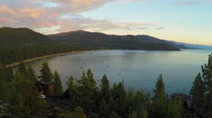 An aerial shot over a romantic couple looking out over Lake Tahoe, Nevada. Stock Footage
