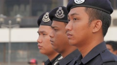 Stock Video Footage of Military stand in respect to anthem,Kuala Lumpur,Malaysia