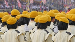 Women in uniform with yellow beret,Kuala Lumpur,Malaysia Stock Footage