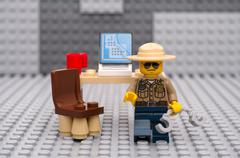 Lego sheriff going to arrest - stock photo