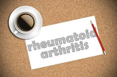 Coffee and pencil sketch rheumatoid arthritis on paper Stock Photos