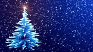Stock Video Footage of Christmas Tree Glowing Blue Lights with Falling Snowflakes.