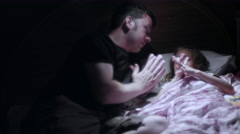 A father and his daughter pray before bed Stock Footage