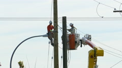 City Hydro Linemen Working As A Team Stock Footage
