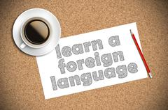Coffee and pencil sketch learn a foreign language on paper Stock Photos