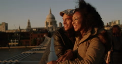 Portrait of a happy affectionate couple standing together outdoors in London. Stock Footage