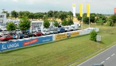 Stock Video Footage of view of the highway nearby the building of renault company with their logo