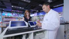 Stock Video Footage of Chemist delivers medicines to a young woman