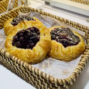 Close up of Blueberry Pies in basket at bakery shop Stock Photos