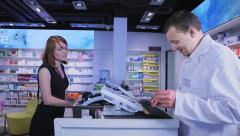 Stock Video Footage of Attractive young woman buying medicine at the chemist's