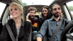 Four cool friends in car ready to go in vacation Stock Footage