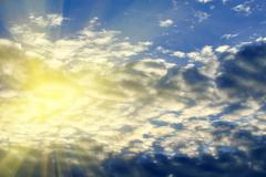 Sun and clouds - stock photo