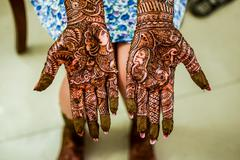 Henna Mehendi on a brides hand Stock Photos