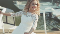 Young and happy bride and groom in wedding clothes outdoor near the river Stock Footage