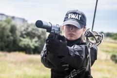 Female police officer SWAT - stock photo