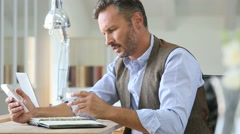 Trendy businessman writing on agenda Stock Footage