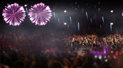 crowd of people and fireworks explosions (slider cam) - stock footage