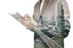 Double exposure of city and Businessman use Tablet device Stock Illustration