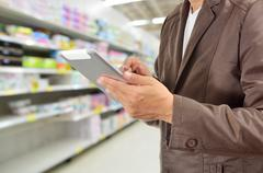 Young Man Hands holding Tablet in Supermarket Stock Photos