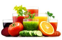 Glasses with fresh organic vegetable and fruit juices isolated on white. Deto - stock photo