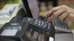 Man paying with NFC technology on mobile phone in the shop Stock Footage