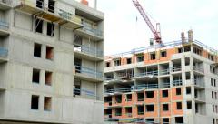 view of the construction wite with base of the large house in the suburb - tall  - stock footage
