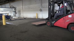 Stock Video Footage of Fork-lift truck is slowly placing down a pallet