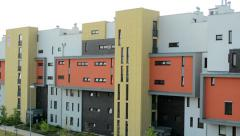 Modern housing estate in the suburb - colorful geometric facade Stock Footage