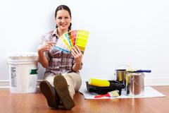 Beautiful woman with painting tools. - stock photo