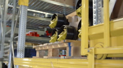Stock Video Footage of Fork-lift truck is lifting up a heavy load
