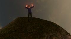 Man Cheering on Mountain Summit:  Looping Stock Footage