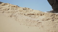 Close-up of  man leg/shoe going alone in the desert. Stock Footage