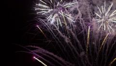 Colorful fireworks with reflection on lake and night sky in background. Stock Footage