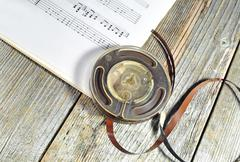 Old tape with music notes - stock photo