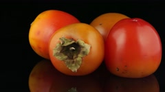 Red ripe persimmons Stock Footage