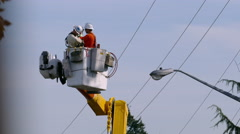City Hydro Linemen Descending Together in Bucket Stock Footage