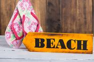 Stock Photo of Direction sign with beach