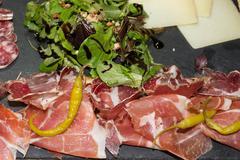 Stock Photo of Traditional italian antipasto with prosciutto, cheese,