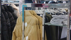 Man Choosing Clothes In Shop Stock Footage