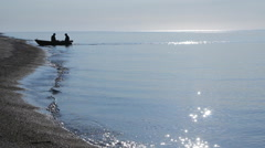 The boat with the fishermen moor to the shore - stock footage