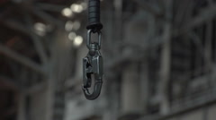 The metal carabiner for loading - stock footage